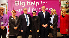 Members of Small Business Victoria and The Victorian Small Business Commission stand in front of the Small Business Bus.